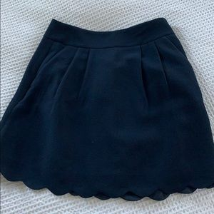 Scalloped edge navy skirt with pockets